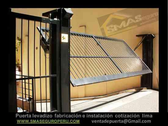 Fotos de fabricaci n de puertas para garajes en lima for Puertas para garajes